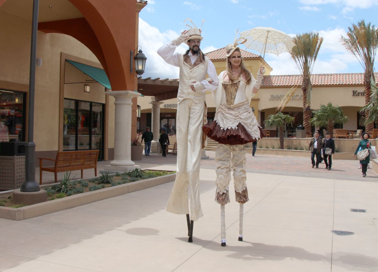 currently crushing, stilt walkers, desert hills premium outlets expansion